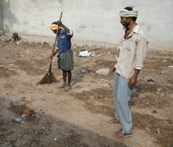 Safai karmacharis cleaning up open defecation without any safety equipment.  Pic source: Thamate.
